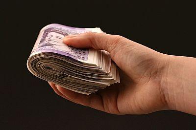 hand-full-of-cash