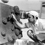 Yves Klein making Untitled Sponge Relief (RE 28) on the beach in Malibu, California, June 1961. © 2010 Artists Rights Society (ARS), New York/ADAGP, Paris. Courtesy Yves Klein Archives